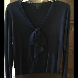 Navy light wool sweater with bow.